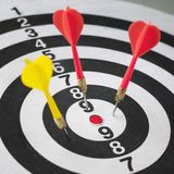 Closeup of dart board with arrows. Concept of loosing Royalty Free Stock Photography