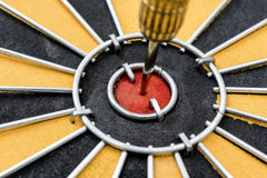 Closeup dart target with arrow on bullseye Royalty Free Stock Image