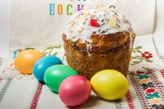 Closeup decorated easter bread and dyed easter eggs. Closeup decorated easter bread and coloful dyed easter eggs served on traditional embroidered towel stock photography