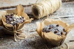 Closeup of decorating chocolate muffins Stock Photos