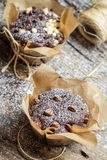 Closeup of decorating chocolate muffins with string. On old wooden table Stock Photography