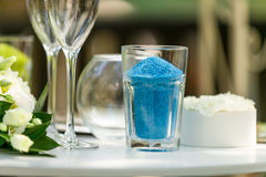 Closeup of decorative blue sand in vase for wedding ceremony Stock Photos
