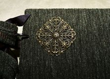 Closeup of a decorative element on a cover of handmade vintage-looking photoalbum.  Stock Photo