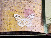 Closeup of a decorative element in a handmade photoalbum stock images