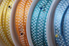 Closeup of decorative ribbons. And pins Royalty Free Stock Images