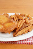 Closeup deep fried fish and chips Stock Images