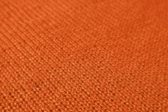 Closeup of Deep Orange Color Colored Alpaca Knitted Wool Fabric in Diagonal Patterns. Texture Background, abstract, backdrop, banner, bright, brown, cloth stock photography