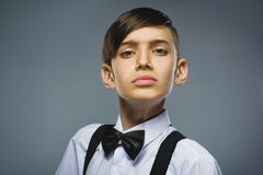 Closeup defiant boy with worried stressed face expression stock image