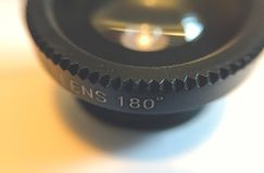 Closeup of an 180 degrees lens. For smart phones Stock Photos