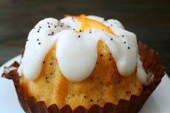 Closeup Delectable Orange Poppy Seed Yogurt Cake on White Plate. Food texture background royalty free stock photos
