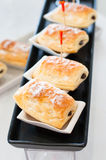 Closeup delicious appetizers sweet puff pastries. Royalty Free Stock Photos