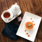 Delicious cake served on wooden table with tea royalty free stock photos