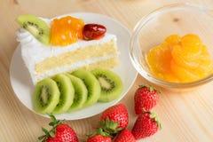 Closeup delicious fresh dessert strawberry orange kiwi fruit wit Stock Image