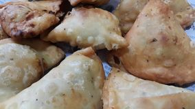 Closeup of delicious home made samosa or pastries food on white background royalty free stock images