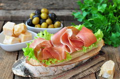 Closeup of delicious parma ham sandwich on wooden backgraund table Stock Image