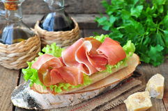 Closeup of delicious parma ham sandwich on wooden backgraund table Stock Images