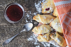 Closeup of a delicious pastry stuffed with berries, on wooden bo. Baking with jam from berries on a wooden board in rustic style. Top view. Vintage style Stock Photos