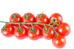 Closeup of a delicious red ripe cherry tomatoes  on white Stock Images