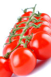Closeup of a delicious red ripe cherry tomatoes  on white Stock Photography