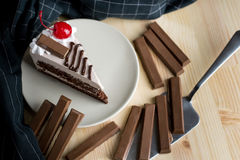 Closeup delicious sweet dessert slice chocolate cherry on brown Stock Images