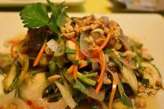 Closeup of delicious vietamese sour spicy beef salad with banana blossom and carambola. Closeup of delicious vietamese sour spicy beef salad with yellow banana royalty free stock images