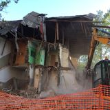 Closeup of Demolition by Backhoe of Old Building. Stock Images
