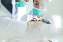Closeup of dentistry student practicing on a medical mannequin.  royalty free stock image