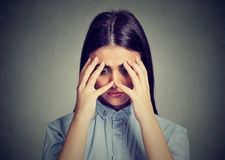 Closeup depressed sad woman looking down leaning head on hand. Depressed sad woman looking down leaning head on hands Stock Images