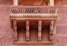 Closeup of the design of the balcony inside Jodha Bai Palace in Fatehpur Sikri complex. Fatehpur Sikri, India, built by the great Mughal emperor, Akbar royalty free stock photos