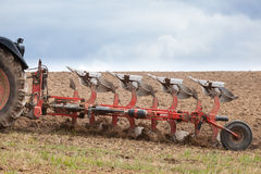 Closeup detail of an agricultural  plough in action Royalty Free Stock Photo