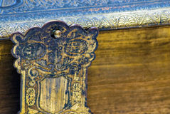 Closeup detail of an ancient book. A clasp of an ancient book, latching onto the front cover to keep the book closed and intact Stock Photo