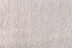 Closeup detail of beige carpet texture Royalty Free Stock Photo
