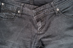 Closeup detail of black denim jeans trousers pocket Stock Image