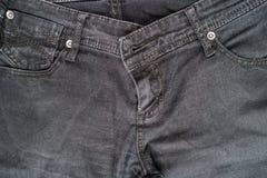 Closeup detail of black denim jeans trousers pocket Stock Image