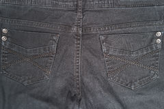 Closeup detail of black denim jeans trousers pocket Royalty Free Stock Image