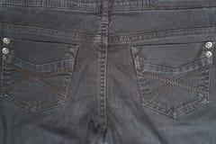 Closeup detail of black denim jeans trousers pocket Royalty Free Stock Image