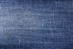 Closeup detail blue jeans fabric background Royalty Free Stock Photo