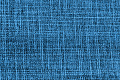 Closeup detail of blue jeans fabric background Royalty Free Stock Images