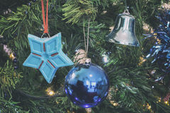 Closeup detail of christmas tree with decorations analog camera style Royalty Free Stock Photo