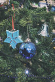 Closeup detail of christmas tree with decorations analog camera style Stock Images