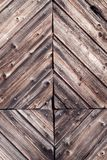 Closeup detail of decorative rustic woodwork and nails with natural weathered dark vintage wood on a rural farm facade -. Wooden antique background with royalty free stock photography