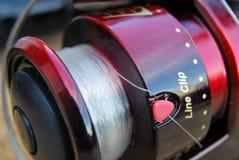 Fishing reel. Closeup detail of a fishing reel Royalty Free Stock Photography