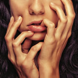 Closeup detail girl face. Closeup detail cosmetics girl face and hands and fingers royalty free stock images