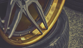 Closeup detail of Gold Aluminum car wheel Royalty Free Stock Images