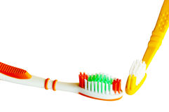 Closeup Detail Of Isolated Colored Toothbrushes on White Royalty Free Stock Photos