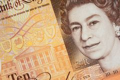 UK Ten Pound Note. Closeup detail of latest edition United Kingdom ten pound polymer note with image of Queen Elizabeth and the Bank of England stock image