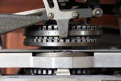 Detail of a vintage dog tag maker machine. Closeup detail of the letters and numbers of a vintage dog tag labeling system Royalty Free Stock Photography