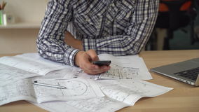 Closeup detail man architect texting message. Close up worker in creative agency holding smartphone stock footage