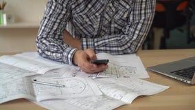 Closeup detail man architect texting message. stock footage