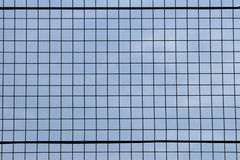 Closeup detail of metal grid. Against a blue sky background Royalty Free Stock Photo